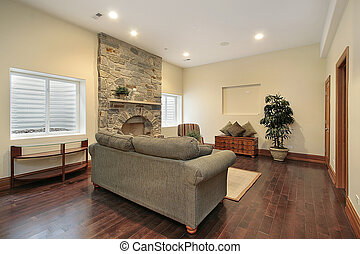 Basement with stone fireplace - Lower level basement in...