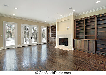 Family room with fireplace in new construction house