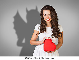 Businesswoman stands with shadow on the wall - Businesswoman...