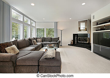 Family room with black fireplace - Family room in luxury...