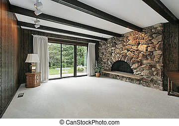 Family room with stone fireplace - Family room with wood...