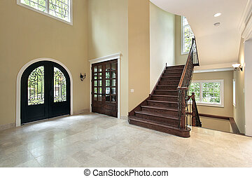 Foyer in new construction home with staircase