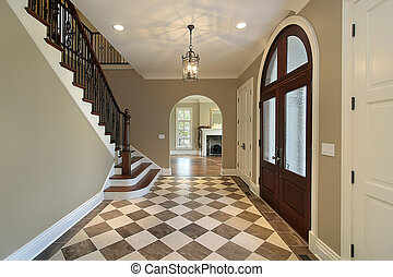 Foyer with checkerboard floor - Foyer in new construction...