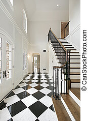 Foyer with checkerboard floor - Foyer in luxury home with...