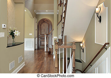 Family room in new construction home - Foyer in new...