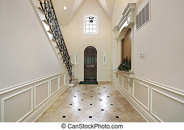Foyer in new construction home with front door view