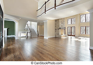Large foyer with stone fireplace in family room