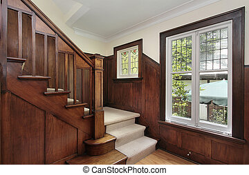 Foyer with wood paneling - Foyer in traditional home with...
