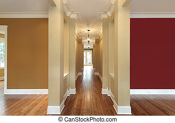 Foyer in new construction home with colorful walls