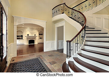Foyer with view into living room - Foyer with staircase and...
