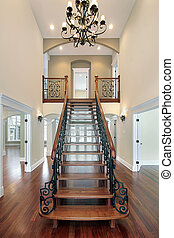 Foyer in new construction home - Elaborate railing on...