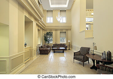 Lobby with sitting area - Lobby in condominium complex with...