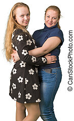 Mother and teen daughter embracing