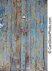 Weathered wood - High voltage sign on weathered wood