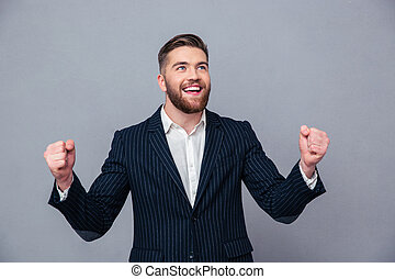 Cheerful businessman celebrating his success - Portrait of a...