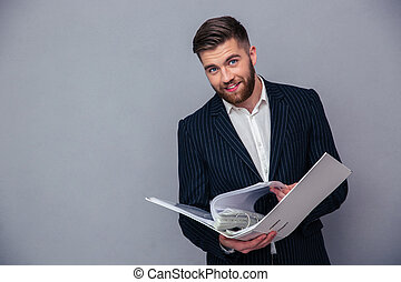 Businessman reading document in folder - Portrait of a happy...