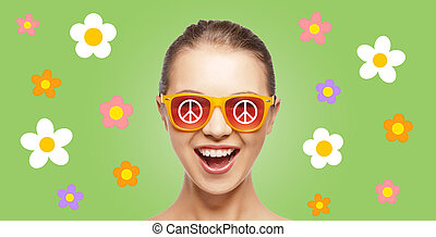 happy teenage hippy girl in shades with peace sign - people,...