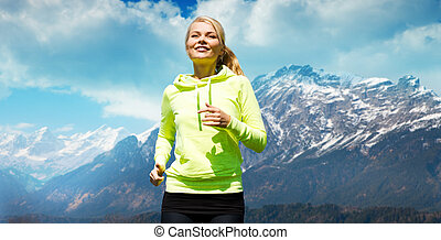 happy sporty woman running or jogging outdoors - people,...