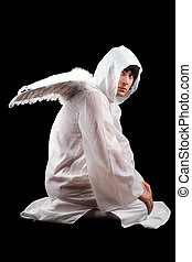 Man wearing white angel suit Isolated on black