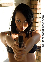 sexy young woman - Portrait of sexy young woman with a gun