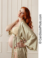 Pregnant woman smiling and standing in sexy underwear - Slim...