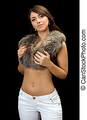 Attractive brunette in fur. Isolated on black