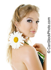 Young woman with daisy flower