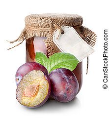 Plums and confiture in a jar isolated on white