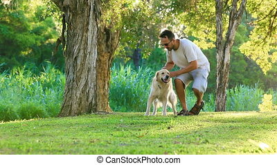Dog and his owner in park together - Dog and his owner in...