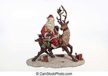 Santa On Deer - Statuette of Santa Klaus on isolated...