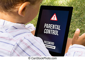 Boy with locked tablet - child with parental control at a...