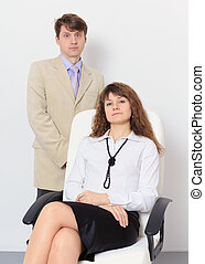 Pair of businessmen on light background - man and woman