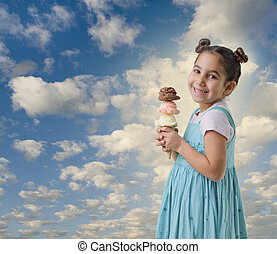 little girl a cone with three ice cream flavors