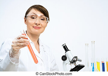 GMO check - Attractive female scientist making tests in...