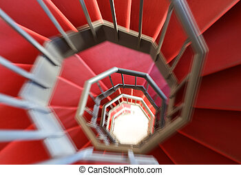 spiral staircase with moving steps and the red carpet - lie...