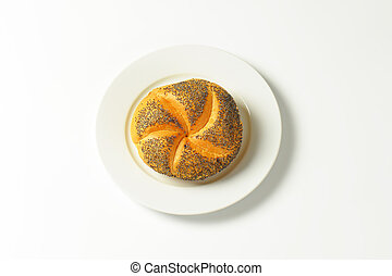 Kaiser roll on white plate - Kaiser roll - part of a typical...