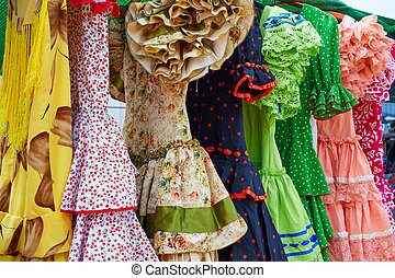 Andalusian gipsy dresses in a row at Spain outdoor market