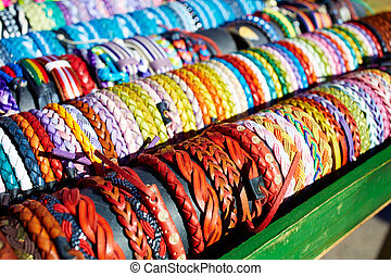 Bracelets of leather in colorful colors hand crafted in an...