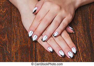 Black and white nail art on wooden background - Black and...