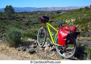 cycling tourism MTB bike in Pedralba Valencia with panniers...