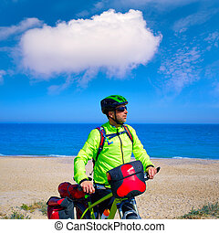 cycling tourist cyclist in Mediterranean beach - cycling...