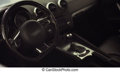 Salon of the luxury car in the dark at the flickering light