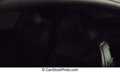 Leather seats of expensive car in the flickering light
