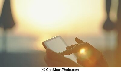 Woman Working With Tablet At Sunset