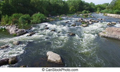 Aerial: flying over river rapids