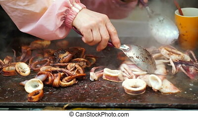 cooking squid cuttlefish hot pan - Teppanyaki cook cutting...