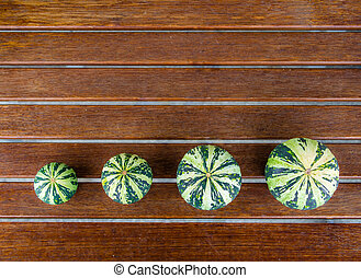 Cucurbita pepo still life green pumkins arranged - Still...
