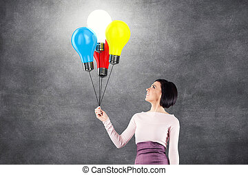 Girl with lightbulbs in the form of balloons