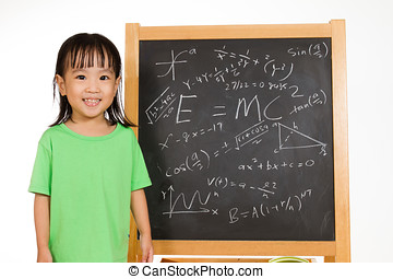 Asian Chinese little girl againts blackboard with formulas -...