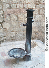 Old water pump in the old town. Kotor, Montenegro.